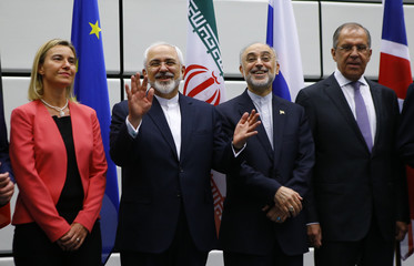 Iranian FM Zarif gestures next to High Representative of the European Union for Foreign Affairs and Security Policy Mogherini, Iranian ambassador to IAEA Salehi and Russian FM Lavrov as they pose for a family photo in Vienna