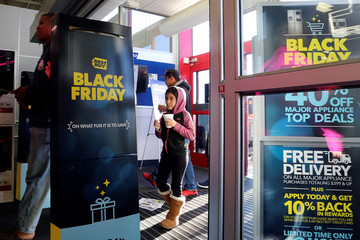 People enter to shop for deals as store doors open during Black Friday sales at a Best Buy store in Los Angeles