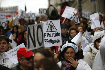 Health workers march against austerity measures in Madrid