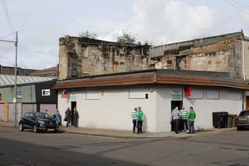 Celtic fans are seen outside a pub in 'The Barras' market area,Scotland