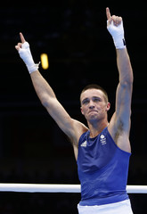Britain's Taylor reacts after defeating Brazil's Conceicao in the men's light (60kg) Round of 32 boxing match during the London 2012 Olympic Games
