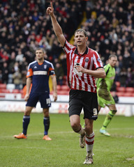 Sheffield United's Porter celebrates after scoring during their FA Cup soccer match against Fulham in Sheffield