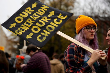 A student participates in the 'Our Generation, Our Choice' protest near the White House in Washington