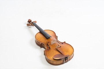 The old fiddle, isolated on white background. Viola, Instrument for classical music.