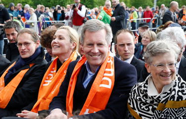 Mayor of Berlin Mueller and former German President Wulff attend the opening service of the German protestant church congress Kirchentag in Berlin