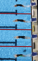 Swimmers compete in the women's 100m backstroke semi-final during the World Swimming Championships at the Sant Jordi arena in Barcelona