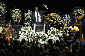 Former Lakers player Magic Johnson speaks at a memorial service for the late Los Angeles Lakers owner Jerry Buss in Los Angeles