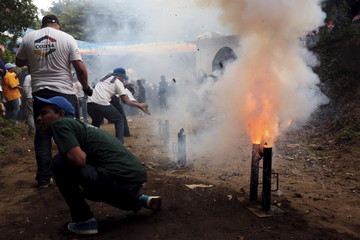 A man fires a homemade mortar during celebrations honouring the patron saint of Managua Santo Domingo de Guzman in Managua