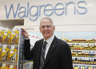 Walgreens CEO and President Wasson poses for a picture prior to a private cocktail event celebrating the grand opening of drugstore chain Walgreens newest flagship store, and 8,000th store nationwide, on the famous corner of Sunset & Vine in Hollywood