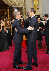 Leonardo DiCaprio greets actor Christoph Waltz on the red carpet at the 86th Academy Awards in Hollywood
