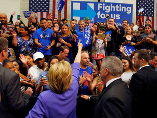 U.S. Democratic presidential candidate Hillary Clinton gives a thumbs-up to supporters during a campaign stop in San Bernardino, California