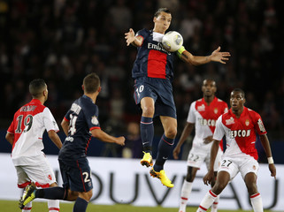 Paris St Germain's Ibrahimovic jumps high to control the ball against Monaco's Obbadi and Kondogbia during their French Ligue 1 soccer match at the Parc des Princes Stadium in Paris