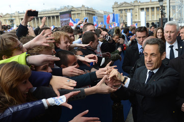France's President and UMP party candidate for the 2012 French presidential elections Sarkozy leaves a political rally on the place de la Concorde in Paris