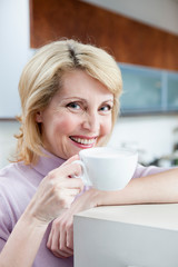 Senior Woman Drinking Cappuccino