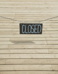 Closed sign over decking
