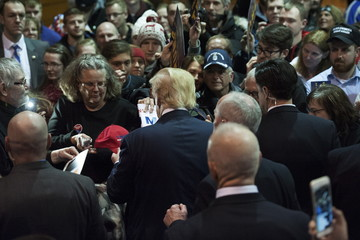 U.S. Republican presidential candidate Trump signs autographs at a campaign event at University of Northern Iowa in Cedar Falls, Iowa