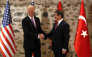U.S. Vice President Biden shakes hands with Turkey's Prime Minister Davutoglu during their meeting in Istanbul