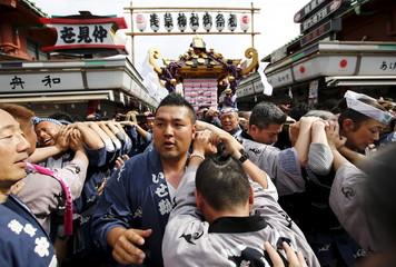 Revellers carry portable shrine during Sanja Matsuri festival in Tokyo