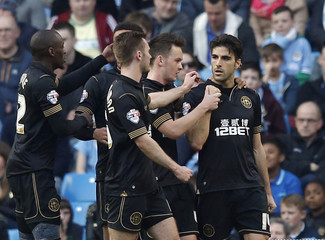 Wigan Athletic's Gomez celebrates after scoring a penalty during their English FA Cup quarter final soccer match against Manchester City at the Etihad stadium in Manchester