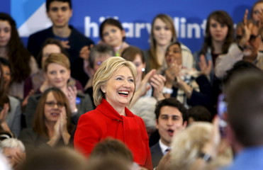 Democratic U.S. presidential candidate Hillary Clinton is applauded as she arrives for the Women for Hillary Get Out the Caucus event Buford Garner Elementary School in North Liberty, Iowa
