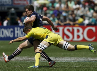 Scotland's Jones is tackled by Australia's Foley at Hong Kong Sevens rugby tournament