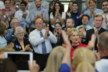 The audience applauds as U.S. Democratic presidential candidate Hillary Clinton takes the stage at a campaign town hall meeting in Manchester