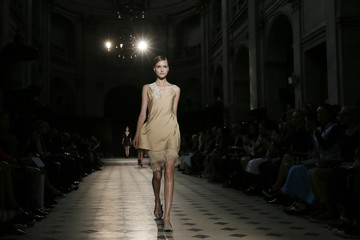 A model presents a creation by Irish designer Sharon Wauchob as part of her Spring/Summer 2015 women's ready-to-wear collection during Paris Fashion Week
