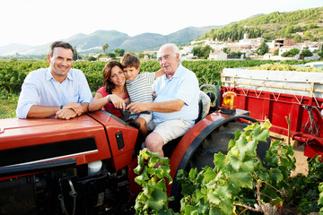 Generational family sitting on tractor