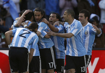 Argentina players celebrate a goal during the 2010 World Cup Group B soccer match against South Korea at Soccer City stadium in Johannesburg