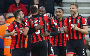 Bournemouth's Steve Cook celebrates scoring their third with teammates