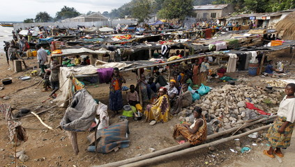 General view shows Burundian refugees with their belongings on the shores of Lake Tanganyika in Kagunga village in Kigoma region in western Tanzania