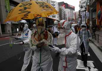 Protesters measure radiation dosage with their Geiger counters during an anti-nuclear march in Tokyo