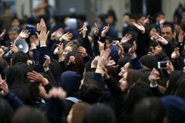 High school students shout slogans during a demonstration against the government to demand changes in the education system in Santiago