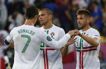 Portugal's Ronaldo, Pepe and Veloso celebrate victory over Denmark in their Euro 2012 Group B soccer match at the new stadium in Lviv