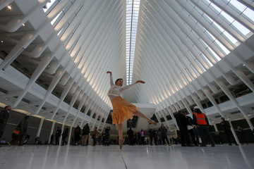 Dancer Laura Rae Bernasconi dances as she poses for photos at the World Trade Center Oculus transportation hub in the Manhattan borough of New York
