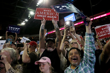 Supporters of Republican presidential nominee Donald Trump cheer at a campaign rally, in Prescott Valley