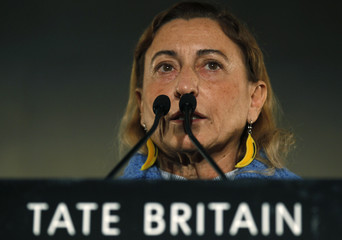Fashion designer Miuccia Prada of Italy announces the Turner Prize 2010 winner at the Tate Britain gallery, in central London