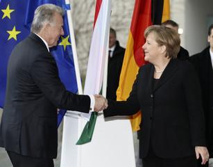 German Chancellor Merkel welcomes Hungarian President Schmitt at the Chancellery in Berlin
