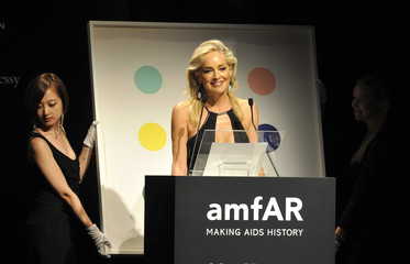 U.S. actress Sharon Stone attends an auction at a charity dinner for The Foundation for AIDS Research (amfAR) during Milan's Fashion Week