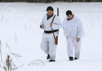 Belarussian hunters look for wolves' footprints during hunting in a forest near the village of Chekhi