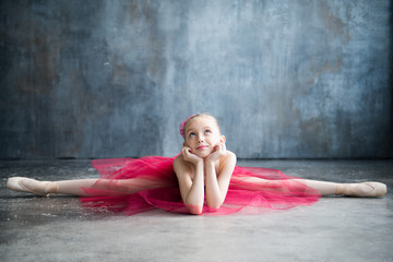 little ballerina doing splits and dreams of future success