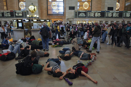 Occupy Wall Street movement activists protest while lying down on the floor of the Grand Central Terminal, in New York