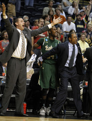 The University of South Florida Bulls bench celebrates pulling ahead of theTemple Owls during their men's NCAA basketball game in Nashville