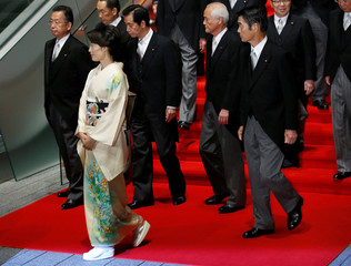 Marukawa leaves from a venue after a photo session at his official residence in Tokyo