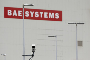 A BAE Systems sign is seen at the entrance to the naval dockyards in Portsmouth