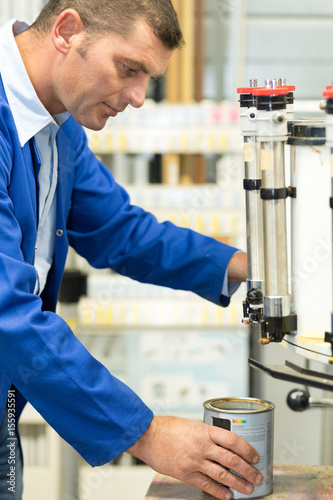 Worker using paint mixing machine stockfotos und - Behr vs sherwin williams interior paint ...