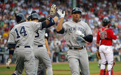 Yankees Granderson and Rodriguez celebrate after scoring behind Red Sox Saltalamacchia in MLB baseball game in Boston