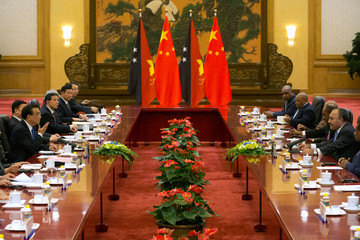 Chinese Premier Li Keqiang speaks during a meeting with Papua New Guinea's PM Peter O'Neill at the Great Hall of the People in Beijing
