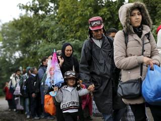 Migrants walk to cross the border from Serbia into Croatia, near the village of Barkasovo