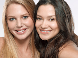 Portrait of two young women side by side